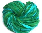 Handspun yarn, 67 yards and 2.2 ounces/62 grams spun thick and thin in hand dyed merino wool