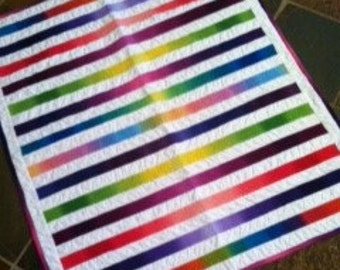 Colorful radiating rainbow baby quilt lap quilt or table topper