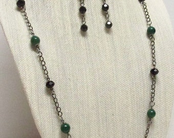 33 inch Green and Black beads with Gunmetal Chain