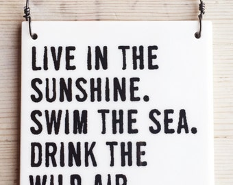porcelain wall tile screenprinted text live in the sunshine. swim the sea. drink the wild air. -emerson