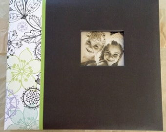 Brand new photo album or scrapbook, with free scrapbook sheets and stickers.