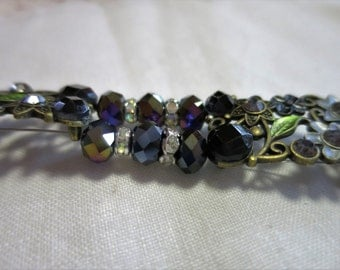 6 1/2  inch bracelet in black pearls with black and gray sliders