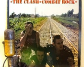 "ON SALE The Clash ""Combat Rock"" Vinyl Record (2nd 1982 Pressing Epic Records with lyric inner sleeve, featuring ""Rock the Casbah"")"