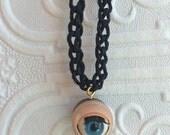 BLINKING DOLL EYE Pendant Black Hemp Necklace Plastic
