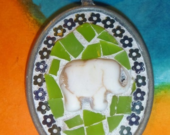 Oval elephant mosaic pendant with lime green and flower background