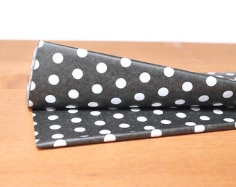 black tissue paper: black and white polka dot gift wrap, tissue, stuffing