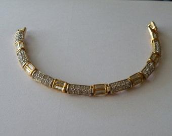 Signed Swarovski Gold Plated with Crystals tennis bracelet