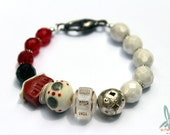 The red house - artisan bracelet in white, red and black with handmade lampwork glass and ceramic beads and Czech glass