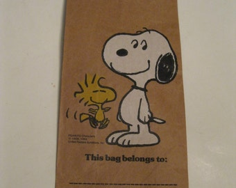 "Fun Blast From Your Past Peanuts Characters Snoopy and Woodstock Pictured on Brown Bag Reads ""This bag belongs to:"" A Fun Collectible Memory"