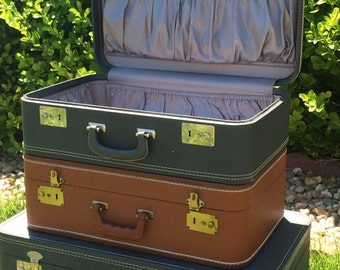 Suitcase Stack Hard Suit Case With Fabulous Ruffled Storage Set Of Three Includes Two Grey Blue Cases With One Odd Orange Coordinating