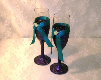 Toasting Flutes or Wine Glasses Glittered in Purple With Your Choice of Ribbon Color and Crystal Accents, Peacock Wedding Colors