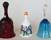 Set of 3 Very Pretty Bells Avon Deep Red Cape Cod April Sweet Violet Royal Botanic Gardens Wildflower Collection And Blue Blown Glass