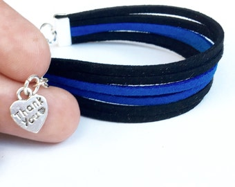 thin blue line bracelet. support police officers, police officers wife, leow. faux suede with a lobster clasp.