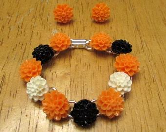 SALE Handmade Halloween Resin Cabochon flower bracelet and matching earrings--Orange, Black and White