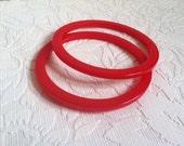 two cherry red bakelite bangle spacer bracelets