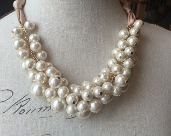 Gold chain tan ribbon and ivory pearl cluster necklace