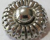 "Large 1.5"" ins vintage metal button.Central dome, open petal like rim, sitting in metal basket.Metal loop sew through.Unusual. CLAM16.3-17.2"