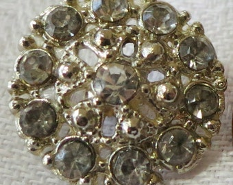 """3 Vintage buttons, 0.65"""" ins across, open work metal with rhinestones in the rim. and one in the center. Pretty. Sparkle. CLAM15.3-4.9-30."""