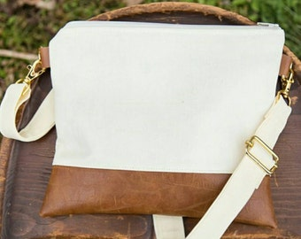 Cream canvas and faux leather crossbody purse