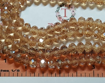 1 strand of 16 inches of 8x6mm Faceted Rondelle Champagne color Chinese Crystal
