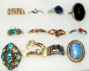 12 Vintage Rhinestone rings, 1 signed Avon