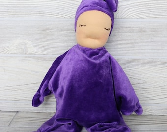 """Ready to ship Waldorf inspired """"star"""" baby in purple."""
