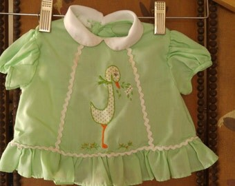 70s baby girl Green dress with polka dot stork motif
