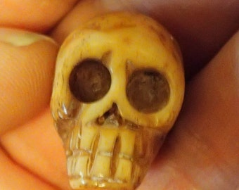 Small Grinning Skull Head Carved Bone Bead pendant