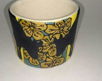 Juice cup with cows and flowers