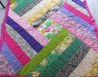 Lovely colorful quilt 48X52, with yellow fleece back,