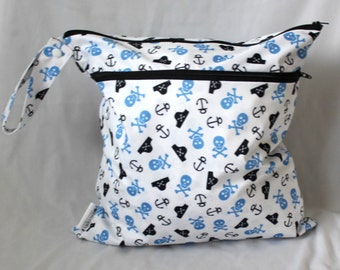 Wet and dry bag. Double zippered bag. 2 compartments. pirate skulls Print Large 14x16 will fit approx 10-12 diapers