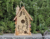 Birdhouse with laser cutout, wine cork art