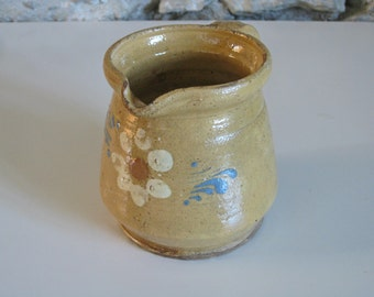 French stoneware  pitcher with yellow glaze and hand painted flowers