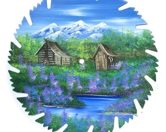 Hand Painted Saw Blade Mountain Spring Log Cabin and Out House