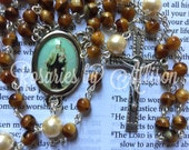 Milky Caramel Czech glass and Cream Preciosa pearl bead rosary with silver plated color Our Lady of Mount Carmel center and ornate crucifix