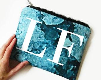 Romy crystal print monogram portfolio clutch bag