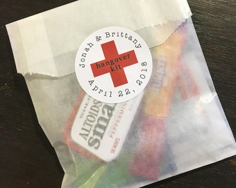 DIY Hangover Kit, first aid for wedding guests.  20 glassine favor bags with custom red cross stickers.  Hangover Kit for wedding guests.