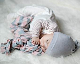 Baby girl swaddle blanket. Pink/ gray stripes. Soft and stretchy knit fabric. Size medium / 31 by 40 inches. Made by lippy brand.