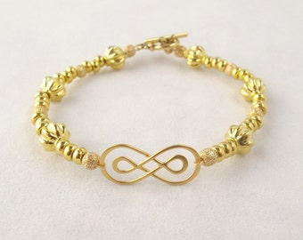Double Infinity Bracelet with Gold Beads and Toggle Clasp