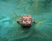 Vintage Costume Ring, 18 Karat Rolled Gold Plate. Clear Rhinestones Surround Larger Central Stone. Size 5.75  Excellent Condition