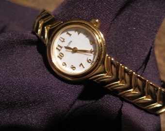 Gold Ladies Bulova Watch, Clasp Band