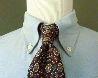 RARE Vintage 1960s Brooks Brothers MAKERS All Silk Multicolored Paisley Pattern on Black Trad / Ivy League Neck Tie.  Printed in England.