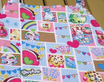 Child sized crafter or baker apron in a Shopkins print.  Lined for extra durability.  Ready to ship