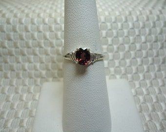 Oval Cut Unheated Red Zircon Ring in Sterling Silver