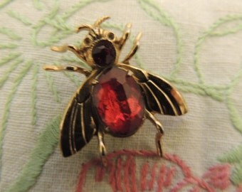 Vintage Coro Insect Brooch / Pin with beautiful ruby colored stones .