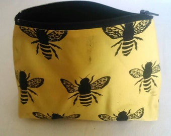 Screen printed bees pouch with black velvet lining