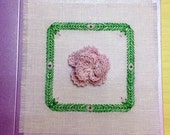 Textile greeting card with crocheted carnation