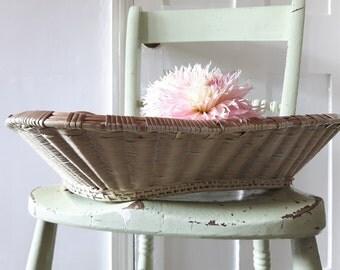 Pretty painted vintage Rattan woven open basket.