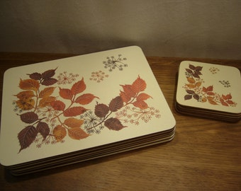 Vintage 1980s place mats and matching coasters with autumn leaves design, autumn leaves placemats and coasters