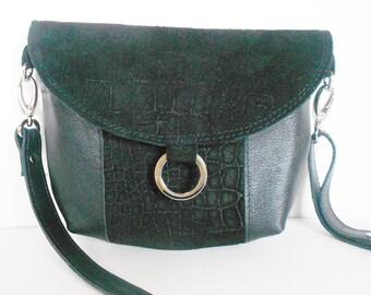 Black leather crossbody bag, or leather shoulder bag with black suede trim.